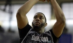 Georgetown's Joshua Smith shoots a free throw against Oregon during the second half of an NCAA college basketball game in the Armed Forces Classic at Camp Humphreys in Pyengtaek, south of Seoul, South Korea, Saturday, Nov. 9, 2013. (AP Photo/Lee Jim-man)