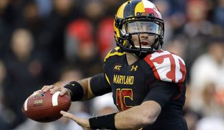 Maryland quarterback C.J. Brown looks to throw during the first half of an NCAA college football game against Syracuse in College Park, Md., Saturday, Nov. 9, 2013. (AP Photo/Patrick Semansky)