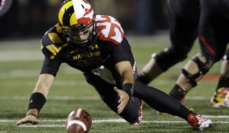 Maryland quarterback C.J. Brown chases after a ball that was hiked between his legs in the second half of an NCAA college football game against Syracuse in College Park, Md., Saturday, Nov. 9, 2013. He regained possession of the ball for a loss. Syracuse won 20-3. (AP Photo/Patrick Semansky)