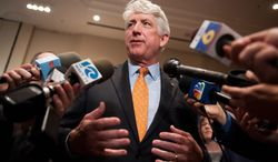 Democratic Va. Attorney General candidate Mark Herring speaks with reporters about the vote count in his election during an election night party in Tysons Corner, Va., Wednesday, Nov. 6, 2013. (AP Photo/Cliff Owen) (associated press photographs)