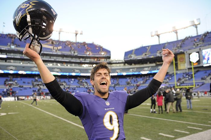 Baltimore Ravens kicker Justin Tucker celebrates his game winning field goal as he leaves the field after a NFL football game against the Cincinnati Bengals in Baltimore, Sunday, Nov. 10, 2013. The Ravens defeated Bengals 20-17 in overtime. (AP Photo/Nick Wass)