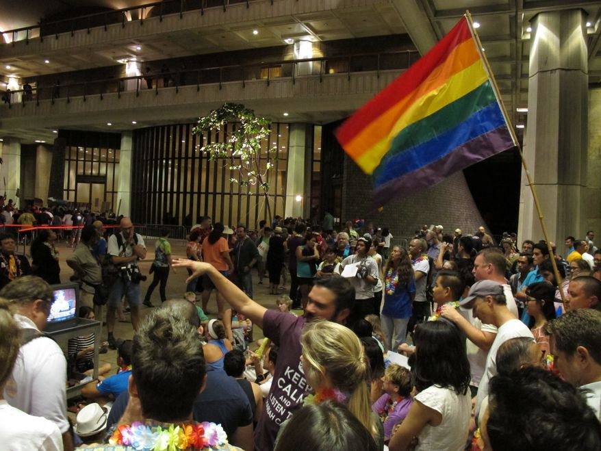 ** FILE ** Proponents of gay marriage rally outside the House chambers at the Hawaii Capitol in Honolulu on Friday, Nov. 8, 2013. (AP Photo/Oskar Garcia)