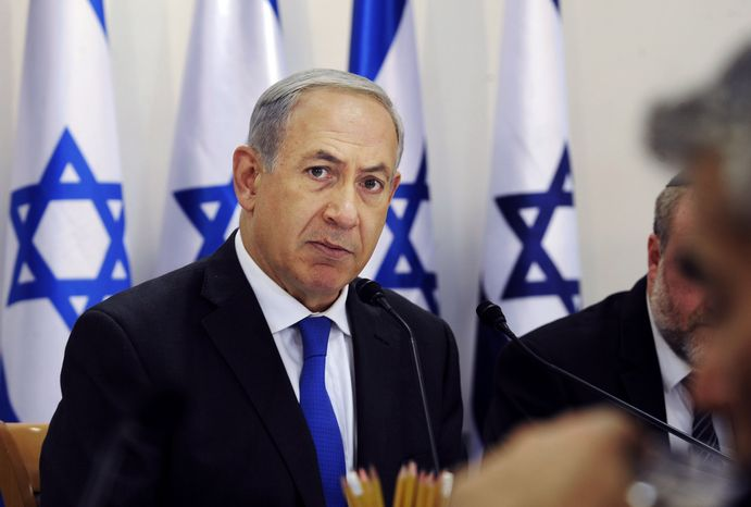 "** FILE ** Israeli Prime Minister Benjamin Netanyahu attends the weekly Cabinet meeting in Sde Boker, Israel, on Sunday, Nov. 10, 2013. Mr. Netanyahu said that Israel would do all it could to keep world powers from striking a ""bad and dangerous"" deal with Iran"