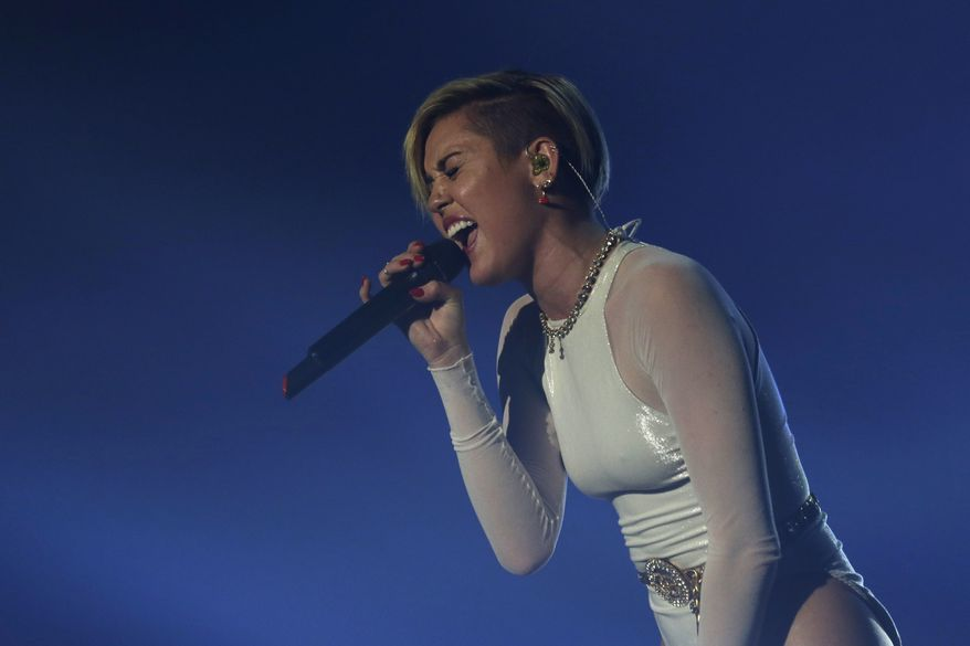 Miley Cyrus performs at the 2013 MTV Europe Music Awards in Amsterdam, Netherlands, Sunday, Nov. 10, 2013. (AP Photo/Peter Dejong)