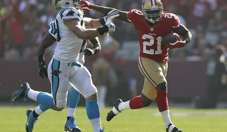 San Francisco 49ers running back Frank Gore (21) stiff-arms Carolina Panthers middle linebacker Luke Kuechly during the first quarter of an NFL football game in San Francisco, Sunday, Nov. 10, 2013. (AP Photo/Marcio Jose Sanchez)