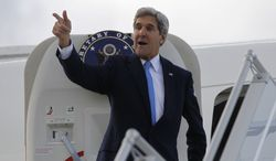 """U.S. Secretary of State John Kerry steps aboard his aircraft in Geneva, Switzerland, Sunday Nov. 10, 2013. Nuclear talks with Iran have failed to reach agreement, but Kerry said differences between Tehran and six world powers made """"significant progress."""" (AP Photo/Jason Reed, Pool)"""