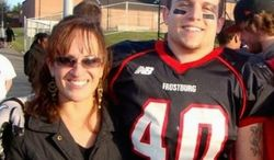"""Frostburg State University football player Derek Sheely with his mother, Kristen (right), who says, """"We're haunted with the terrible unreality all the time."""" (Photograph provided by the Sheely family)"""