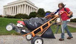 Chris Cox of Mount Pleasant, S.C., pushes a cart near the Lincoln Memorial in Washington, Wednesday, Oct. 9, 2013.  Cox has taken it upon himself to mow and clean up the grounds around the Lincoln Memorial during the government shutdown and has worked at least 100 hours, since he started eight days ago. (AP Photo/Manuel Balce Ceneta) (associated press)