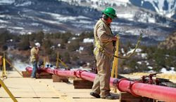 "A worker helps monitor water pumping pressure and temperature, at the site of a natural gas hydraulic fracturing and extraction operation in western Colorado. Tisha Schuller, president of the Oil and Gas Association in Colorado, said, ""Boulder and Lafayette were nothing more than symbolic votes. Lafayette's last new well permit was in the early 1990s and Boulder's last oil and gas well was plugged in 1999."" (ASSOCIATED PRESS)"