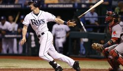 Tampa Bay Rays Wil Myers (9) hits a single in the fourth inning in Game 4 of an American League baseball division series against the Boston Red Sox, Tuesday, Oct. 8, 2013, in St. Petersburg, Fla. (AP Photo/Mike Carlson)
