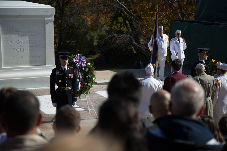 Wreaths are laid at the Tomb of the Unknown Soldier at the Arlington National Cemetery during a Veteran's Day ceremony, in Arlington, VA., Monday, November 11, 2013.(Andrew S. Geraci/The Washington Times)