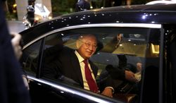 ** FILE ** International Atomic Energy Agency (IAEA) Director General Yukiya Amano leaves the Azadi Hotel after briefing reporters on the progress of nuclear negotiations with Iranian officials in Tehran, Iran, Monday, Nov. 11, 2013. Iran and the U.N. nuclear watchdog agency have reached a roadmap deal for cooperation during talks in Tehran Saturday that expands the monitoring of the country's nuclear sites. (AP Photo/Ebrahim Noroozi)