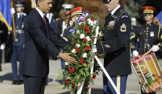 President Barack Obama places a wreath at the Tomb of the Unknowns at Arlington National Cemetery in Arlington, Va., Monday, Nov. 11, 2013, during a Veterans Day ceremony.  (AP Photo/Pablo Martinez Monsivais)