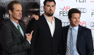 "Film director Peter Berg (from left), retired Navy Petty Officer 1st Class Marcus Luttrell and actor Mark Wahlberg arrive at the 2013 American Film Institute FEST premiere of ""Lone Survivor"" at the TCL Chinese Theatre on Tuesday, Nov. 12, 2013, in Los Angeles. (Jordan Strauss/Invision/AP)"