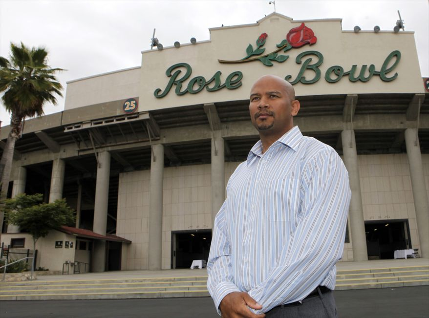 In this photo taken on Thursday, May 27, 2010, Ramogi Huma, president of the National College Players Association, poses for a photo outside the Rose Bowl in Pasadena, Calif. Huma has seen his organization grow to 14,000 members, thanks to the rise of social media and an Internet-driven recruitment strategy. About half the group's members are current athletes, representing 150 Division I programs. (AP Photo/Damian Dovarganes)