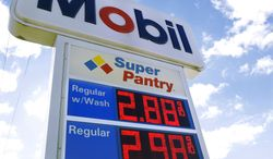 Regular gas is priced at $ 2.88 per gallon at the Mobil gas filling station Tuesday, Nov. 12, 2013, in Chatham, Ill. U.S. pump prices are the lowest they've been since February 2011. (AP Photo/Seth Perlman)