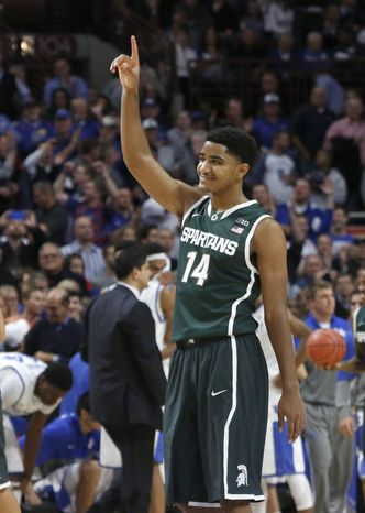 Michigan State guard Gary Harris (14) celebrates the Spartans' 78-74 win over Kentucky in an NCAA college basketball game Tuesday, Nov. 12, 2013, in Chicago. (AP Photo/Charles Rex Arbogast)
