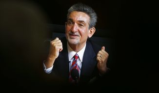 Washington Wizards basketball and Washington Capitals hockey teams owner Ted Leonsis gestures during an interview with The Associated Press in Washington, Tuesday, Nov. 12, 2013.  (AP Photo/Charles Dharapak)