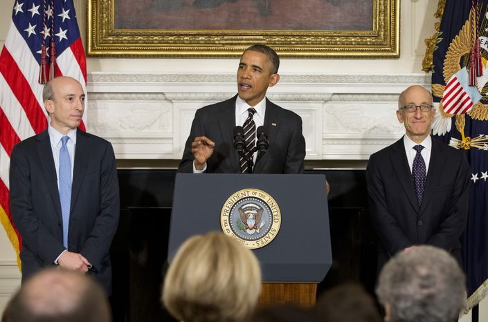 President Barack Obama, flanked by outgoing Commodity Futures Trading Commission (CFTC) Chairman Gary Gensler, left, and his nominee to become CFTC Chairman Timothy Massad, makes the announcement, Tuesday, Nov. 12, 2013, in the State Dining Room of the White House in Washington. (AP Photo/ Evan Vucci)