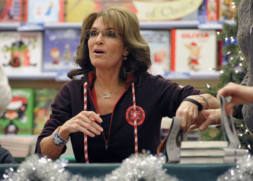 """Former Alaska Gov. Sarah Palin, the 2008 Republican vice presidential candidate, signs copies of her new book, """"Good Tidings and Great Joy: Protecting the Heart of Christmas,"""" on Tuesday, Nov. 12, 2013, in Bethlehem, Pa. (AP Photo/The Express-Times, Matt Smith)"""