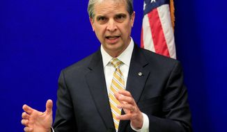 Republican attorney general candidate Mark R. Obenshain announces his transition team Wednesday, hours after Democratic candidate Mark R. Herring announces his own as both teams await official certification Nov. 25. (associated press)
