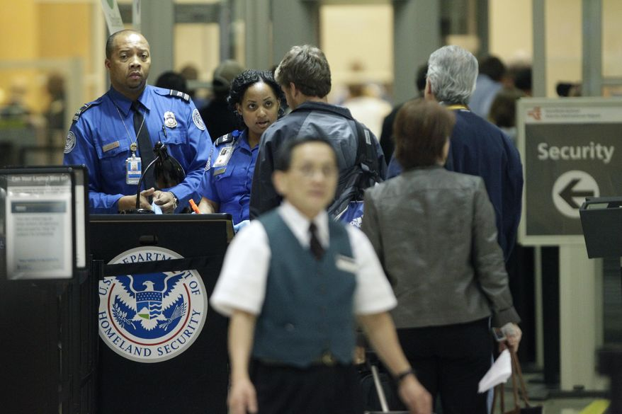 Transportation Security Administration officials check check passengers entering a security checkpoint at Hartsfield-Jackson Atlanta International Airport in Atlanta on Nov. 18, 2010. (Associated Press) **FILE**