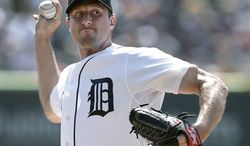 Detroit Tigers pitcher Max Scherzer throws against the Oakland Athletics in the first inning of a baseball game in Detroit, Thursday, Aug. 29, 2013.  (AP Photo/Paul Sancya)