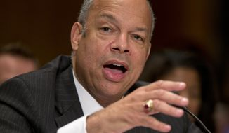 **FILE** Jeh Johnson, President Barack Obama's choice to become Homeland Security Secretary, testifies on Capitol Hill on Nov. 13, 2013, before the Senate Homeland Security and Governmental Affairs Committee hearing on his nomination. (Associated Press)