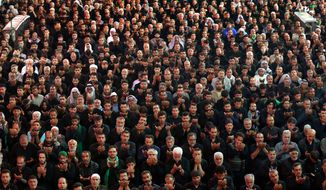 Shiite faithful worshippers pray inside the holy shrine of Imam Abbas during Muharram, an important period of mourning for Shiites in the Shiite holy city of Karbala, 50 miles (80 kilometers) south of Baghdad, Iraq, Wednesday, Nov. 13, 2013. The remembrance of Muharram marks the anniversary of the Battle of Karbala when Imam Hussein, a grandson of Prophet Muhammad, was killed. (AP Photo/Hadi Mizban) **FILE**