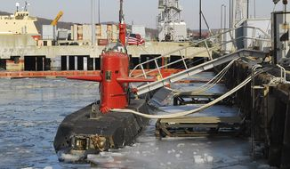 ** FILE ** In this Feb. 2007, file photo provided by the U.S. Navy, the research submarine NR-1 is moored at U.S. Naval submarine base, in New London, Conn. It was taken out of service in 2008 and disassembled, its reactor disposed of. Now the Navy has collected pieces of it for an exhibit at a submarine museum in Groton, where it was based for the duration of its service life. (AP Photo/US Navy, John Fields)