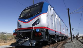 **FILE** One of the new Amtrak Cities Sprinter Locomotive makes a demonstration run during unveiling ceremonies at the Siemens Rails Systems factory in Sacramento, Calif., on May 13, 2013. (Associated Press)