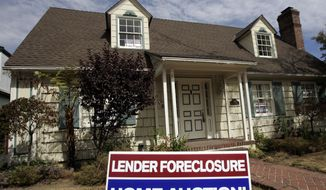 A home is advertised for sale at a foreclosure auction in Pasadena, Calif., in 2007. (AP Photo/Reed Saxon)