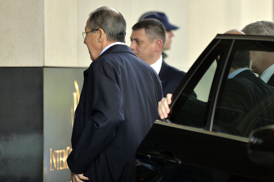 Russian Foreign Minister Sergey Lavrov arrives for closed-door nuclear talks with Iran at the United Nations offices in Geneva on Saturday, Nov. 9, 2013. (AP Photo/Keystone, Martial Trezzini)