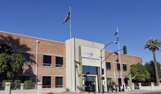This Thursday, Nov. 14, 2013, photo, shows the main entrance of the Lockheed Martin plant in Goodyear, Ariz. Lockheed Martin is cutting 4,000 jobs, about 3.5 percent of its workforce, as the defense contractor continues to look for ways to lower costs amid reduced government spending. The Bethesda, Md.-based Lockheed Martin Corp. said Thursday that it will close plants in Arizona, Ohio, Pennsylvania and Texas, as well as four buildings in a California campus, by mid-2015, eliminating 2,000 jobs. (AP Photo/Matt York)