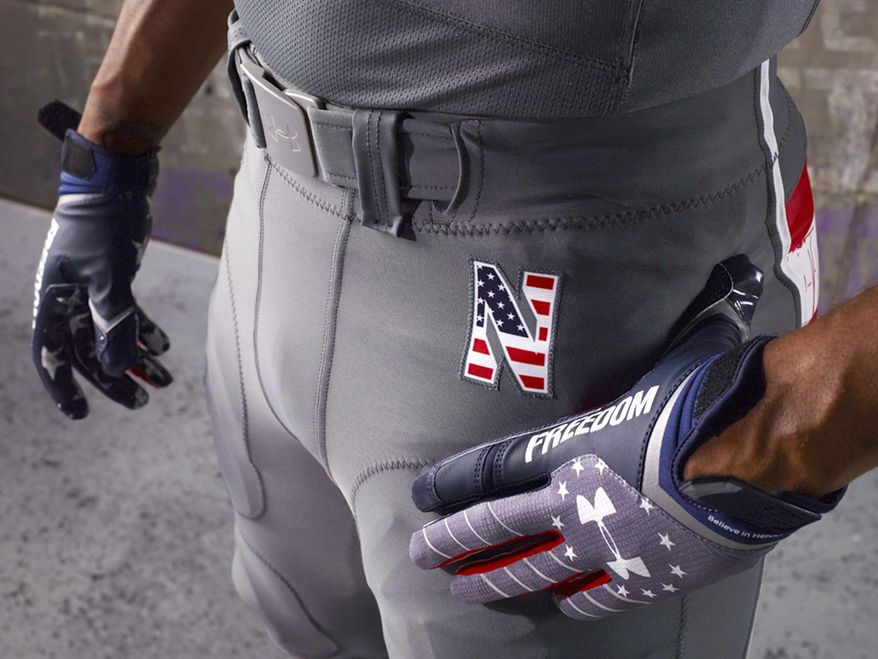 This undated photo provided by Northwestern Athletic Department on Thursday, Nov. 14, 2013, shows a model dressed in the NCAA college football team's new the patriotic-themed uniform. When Northwestern takes the field against Michigan on Saturday, the Wildcats will trade their familiar purple for a set of patriotic uniforms like no other; stars and stripes across the shoulders and a distressed pattern that to some looks like blood stains on a flag. They're simply the latest push by companies that supply athletic equipment to schools to honor the military, and the players love it , especially when they help raise money for soldiers injured in the line of duty. (AP Photo/Northwestern University)