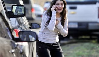 Carlee Soto learns that her sister, Victoria Soto, who was a teacher at the Sandy Hook Elementary School, was one of 26 people killed in the shooting at the school in Newtown, Conn., on Friday, Dec. 14, 2012. (AP Photo/Jessica Hill)