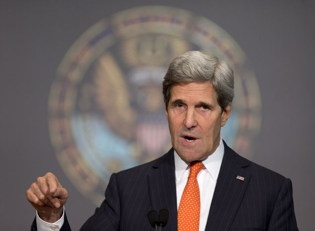 """Secretary of State John Kerry gestures as he speaks at Gaston Hall at Georgetown University in Washington, Friday, Nov. 15, 2013, during the """"Advance Afghan Women"""" symposium. Kerry said Afghanistan is reaching a turning point that will be critical to maintaining advances made by women since the end of Taliban rule. (AP Photo/Carolyn Kaster)"""
