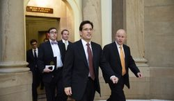 **FILE** House Majority Leader Eric Cantor (center), Virginia Republican, leaves the office of House Speaker John Boehner, Ohio Republican, on Capitol Hill in Washington on Nov. 15, 2013, before a vote on a measure to let insurers keep offering health coverage that falls short of the law's standards. (Associated Press)