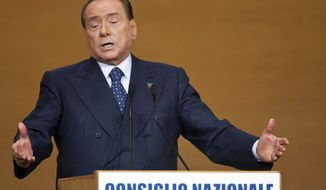 ** FILE ** Silvio Berlusconi gestures as he addresses supporters in Rome, Saturday, Nov. 16, 2013. (AP Photo/Mauro Scrobogna, Lapresse)