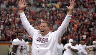 Maryland coach Randy Edsall reacts to a confirmation replay of his team's final score against Virginia Tech in an NCAA college football game in Blacksburg, Va., Saturday, Nov. 16 2013. Maryland defeated Virginia Tech 27-24 in overtime. (AP Photo/The Roanoke Times, Matt Gentry) LOCAL TV OUT; LOCAL INTERNET OUT; LOCAL PRINT OUT (SALEM TIMES REGISTER; FINCASTLE HERALD; CHRISTIANSBURG NEWS MESSENGER; RADFORD NEWS JOURNAL; ROANOKE STAR SENTINEL