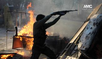 ** FILE ** A Free Syrian Army fighter fires an AK-47 during a battle against the Syrian army loyal to President Bashar Assad, in Aleppo, Syria, Nov. 8, 2013. (AP Photo/Aleppo Media Center AMC, File)