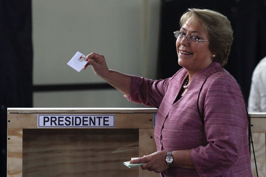Former Chilean President Michelle Bachelet casts her vote during general elections in Santiago, Chile, on Sunday, Nov. 17, 2013. Ms. Bachelet is the front-runner in her race to regain the presidency. (AP Photo/Luis Hidalgo)