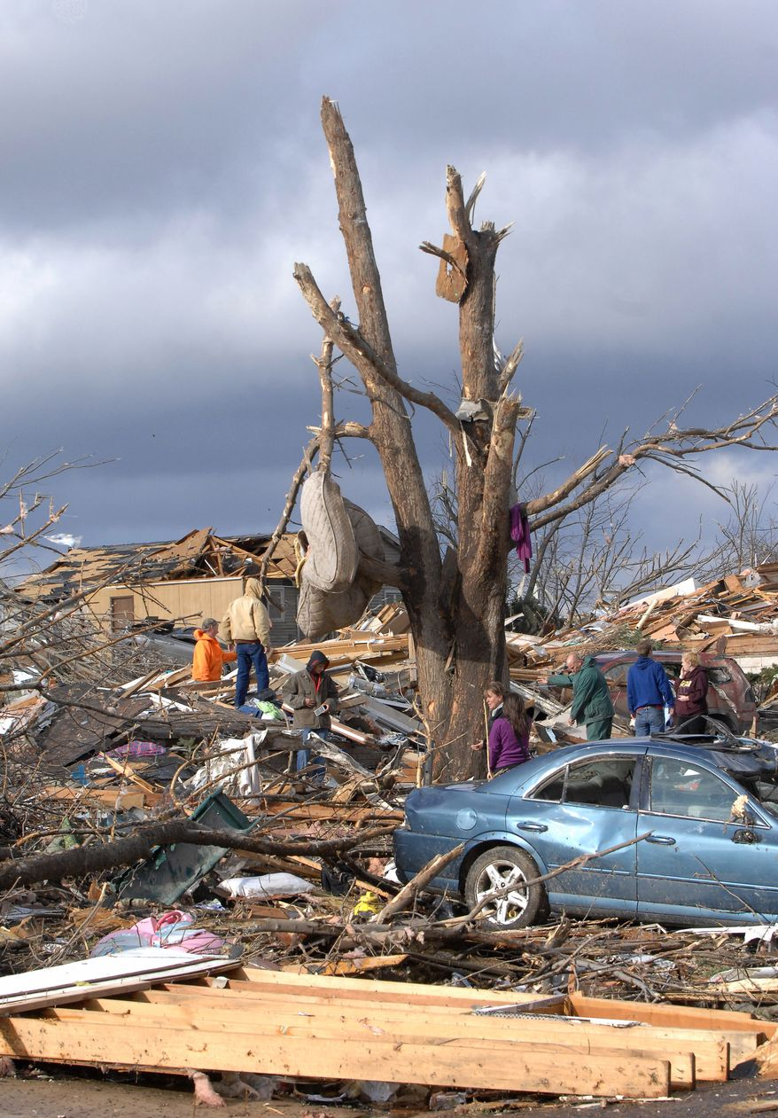 A mattress is wrapped around a stripped tree in Washington, Ill., Sunday, Nov. 17, 2013. Intense thunderstorms and tornadoes swept across the Midwest, causing extensive damage in several central Illinois communities while sending people to their basements for shelter. (AP Photo/The Pantagraph, Steve Smedley)