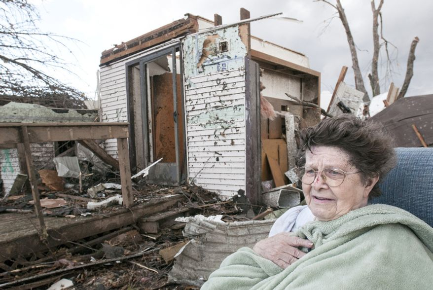 Pat Whitaker, 82, sits under a blanket in her nightgown outside her home waiting for help to come in Gifford, Ill. on Sunday, Nov. 17, 2013. Intense thunderstorms and tornadoes swept across the Midwest, causing extensive damage in several central Illinois communities while sending people to their basements for shelter. (AP Photo/The News-Gazette, Robin Scholz)