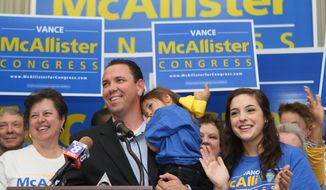 ** FILE ** Vance McAllister celebrates with his family and supporters after winning the 5th Congressional District election with 60 percent of the vote on Saturday, Nov. 16, 2013. (AP Photo/The News-Star, Emerald McIntyre)