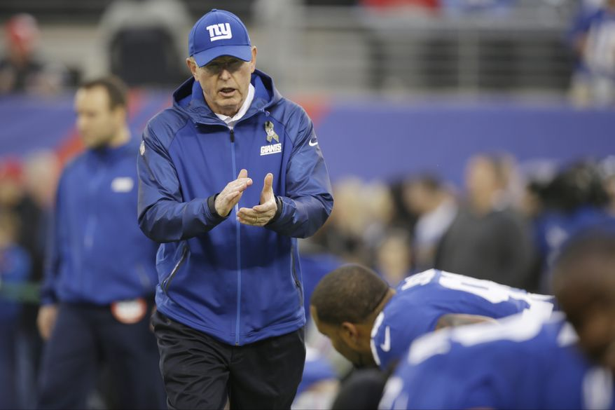 New York Giants head coach Tom Coughlin talks to his team as they warm up before an NFL football game against the Green Bay Packers Sunday, Nov. 17, 2013, in East Rutherford, N.J.  (AP Photo/Seth Wenig)