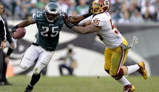 Washington Redskins inside linebacker Perry Riley pushes Philadelphia Eagles running back LeSean McCoy out of bounds during the second half of an NFL football game in Philadelphia, Sunday, Nov. 17, 2013. (AP Photo/Michael Perez)