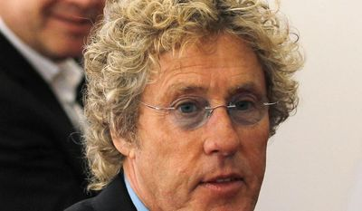 **FILE** British singer and songwriter Roger Daltrey arrives at the Royal Academy of Arts in London for the UK creative industries reception hosted by the British Government supported by the Founders Forum on July 30, 2012. (Associated Press)