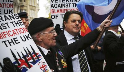 "Nick Griffin, centre chairman of the far-right, British National Party joins members of the British Veterans' Group outside the Central Criminal Court the ""Old Bailey"" in London Monday Nov. 18, 2013,  ahead of a court hearing of Michael Adebolajo, 28, and Michael Adebowale, 22,  who are charged with the murder of British soldier Lee Rigby in May earlier this year. (AP Photo/Gareth Fuller/PA) UNITED KINGDOM OUT NO SALES NO ARCHIVE"