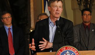 **FILE** Colo. Gov. John Hickenlooper speaks to members of the media during a news conference at the state Capitol in Denver on Nov. 18, 2013. (Associated Press)